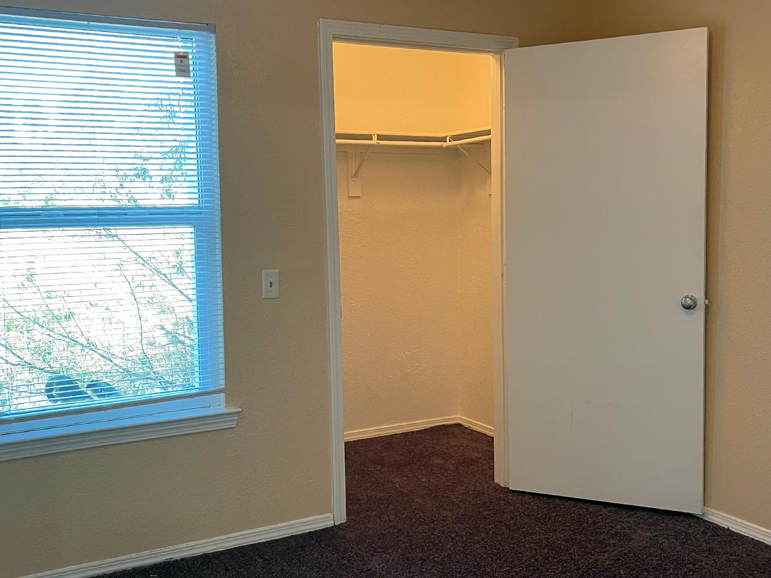 Photo Of A Grand Apartment Master Bedroom Closet.
