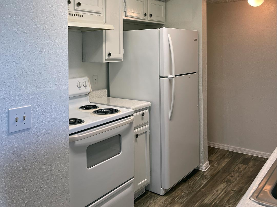 Photo Of A Nice View OF The Apartment Dining Space From The Kitchen.