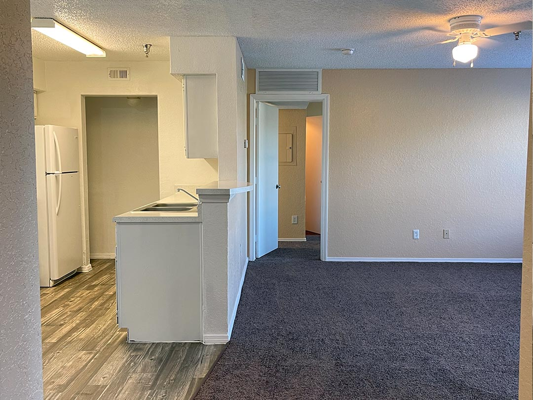 Photo Of A Spacious Apartment Living Room And Kitchen.